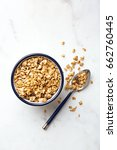 oatmeal in a bowl. fresh and... | Shutterstock . vector #662760445