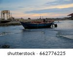 fishing boats are parked at the ... | Shutterstock . vector #662776225