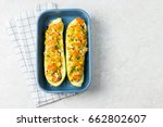 Stock photo zucchini pizzas in a baking dish on white table healthy gluten free dinner 662802607