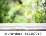 outdoor wooden table  | Shutterstock . vector #662807767
