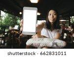 young asian woman show blank... | Shutterstock . vector #662831011
