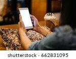 hand of woman using smart phone ... | Shutterstock . vector #662831095