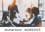 young team of coworkers making... | Shutterstock . vector #662831515