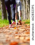 young couple jogging in park at ... | Shutterstock . vector #662832391