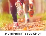 young couple jogging in park at ... | Shutterstock . vector #662832409