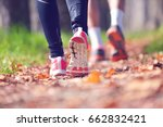 young couple jogging in park at ... | Shutterstock . vector #662832421