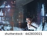 Small photo of Concept of digital diagram,graph interfaces,virtual screen,connections icon.Young finance analist working at modern office.Man using contemporary laptop at night,blurred background.Horizontal