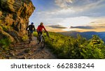 mountain biking women and man... | Shutterstock . vector #662838244