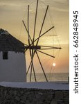 Small photo of Sunset in the Aegean with windmills