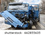 Small photo of Damaged big truck after car accident with many damages on road at winter