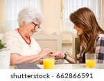senior woman trying to read the ... | Shutterstock . vector #662866591