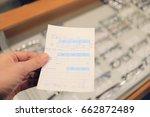hand holds doctor eyeglass... | Shutterstock . vector #662872489