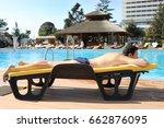 man sunbathes on longue near... | Shutterstock . vector #662876095