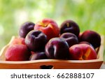 Plums And Peaches On Wooden...