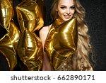 beautiful blonde woman on black ...   Shutterstock . vector #662890171