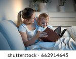beautiful smiling mother... | Shutterstock . vector #662914645