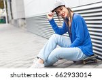 young girl sitting on... | Shutterstock . vector #662933014