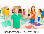 happy kid boy playing jumping...   Shutterstock . vector #662948011