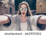 shocked girl in sunglasses and... | Shutterstock . vector #662955301