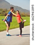 young couple stretching legs... | Shutterstock . vector #662961895