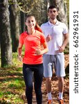 young couple jogging in park at ... | Shutterstock . vector #662961931