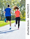 young couple jogging in park at ... | Shutterstock . vector #662962015