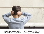 young boy closes ears with... | Shutterstock . vector #662969569