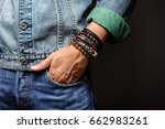 the man in jean jacket wearing... | Shutterstock . vector #662983261