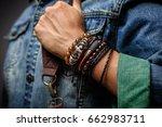 the man in jean jacket wearing... | Shutterstock . vector #662983711