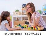 kindergarten teacher plays with ... | Shutterstock . vector #662991811