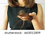 fall hair in woman hand ... | Shutterstock . vector #663011809