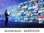 young woman using laptop PC and various pictures. internet streaming service concept. - stock photo