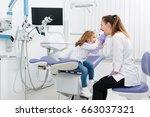 female dental specialist... | Shutterstock . vector #663037321