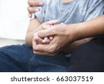 an old man giving the sympathy... | Shutterstock . vector #663037519