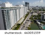 Small photo of MIAMI BEACH, FL, USA - JUNE 11, 2017: Aerial image of Midrise condominiums along Collins Avenue at the end of Indian Creek