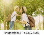 happy family. a son kiss his... | Shutterstock . vector #663124651