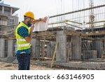 men in hardhat and green jacket ... | Shutterstock . vector #663146905