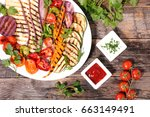 grilled vegetables with sauce | Shutterstock . vector #663149491