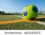 Small photo of consummate soccer green ball at the center of the field