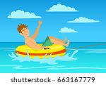 man riding tube at the beach.... | Shutterstock .eps vector #663167779