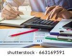 businessman calculating... | Shutterstock . vector #663169591