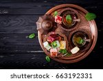 bowl with various pieces of... | Shutterstock . vector #663192331