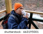 Small photo of Man breathing with mini portable oxygen cylinder to avoid and treat Acute Mountain Sickness