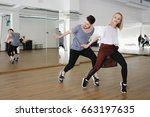young modern dancers dancing in ... | Shutterstock . vector #663197635