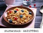 delicious muesli with berries... | Shutterstock . vector #663199861