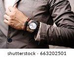 closeup the man's wrist wearing ...   Shutterstock . vector #663202501