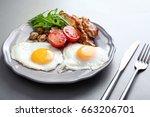 tasty breakfast with eggs on... | Shutterstock . vector #663206701