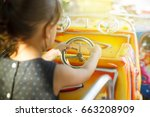 kid driving toy car ride at an... | Shutterstock . vector #663208909