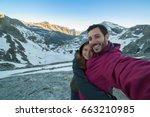 handsome smilling happy couple... | Shutterstock . vector #663210985