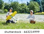 a child launches a model... | Shutterstock . vector #663214999